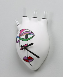 HEARTBEATS CLOCK LOVE Wall clock in the shape of a human heart with a stylized woman's face in Cubist style. Antartidee